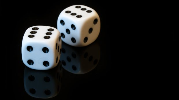 Artistic Wallpaper with Two White Dices in Dark background.