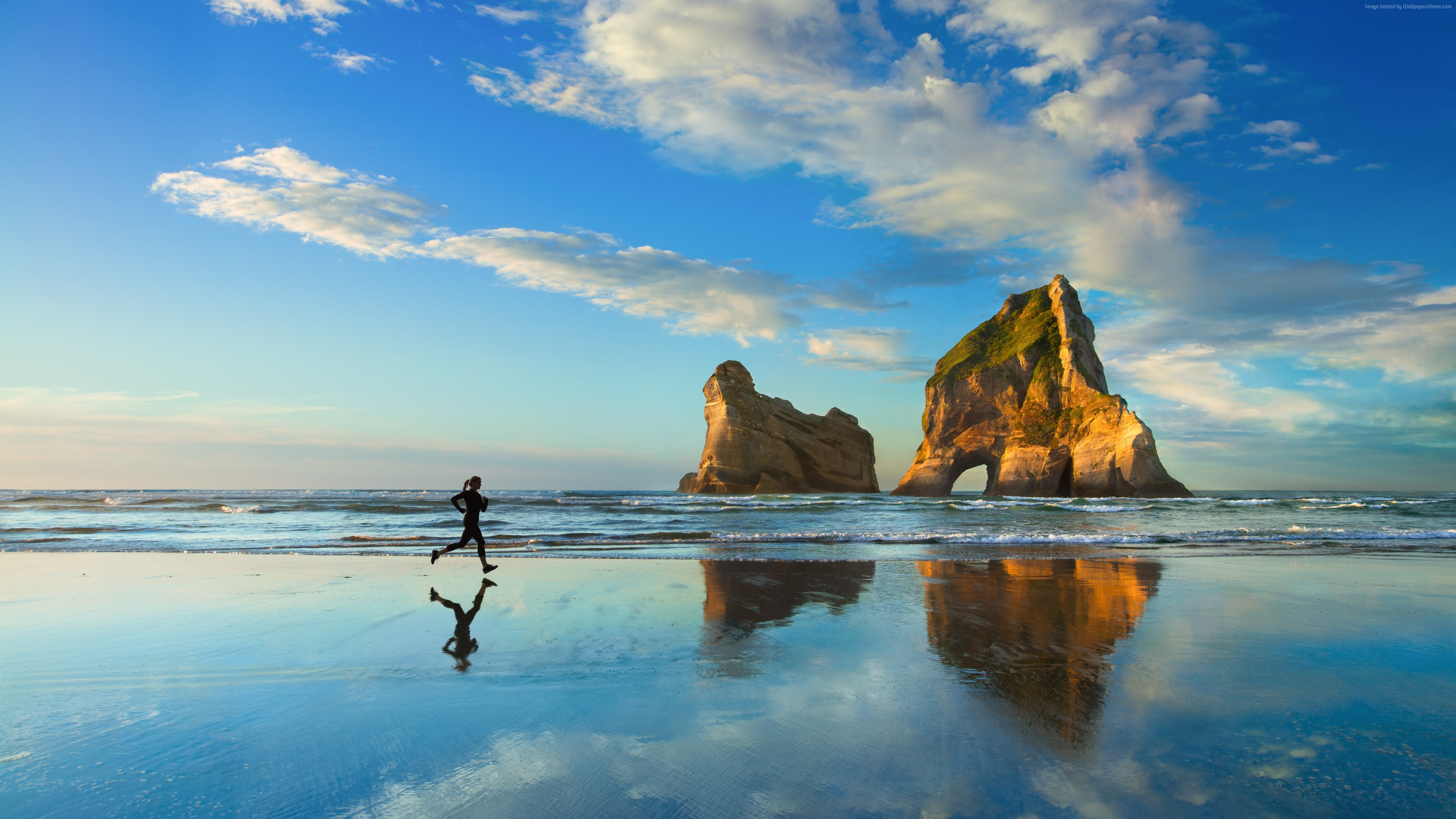 windows 10 4k wallpaper microsoft blue sea woman running.